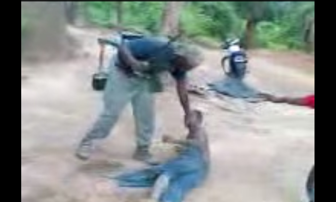 Screenshot of YouTube video reportedly showing security torturing two diamond diggers.
