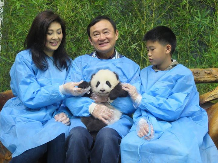 Former Thailand Prime Minister Yingluck Shinawatra (left) with her brother,  ousted Prime Minister Thaksin Shinawatra (center).  Photo from Facebook of Yingluck.