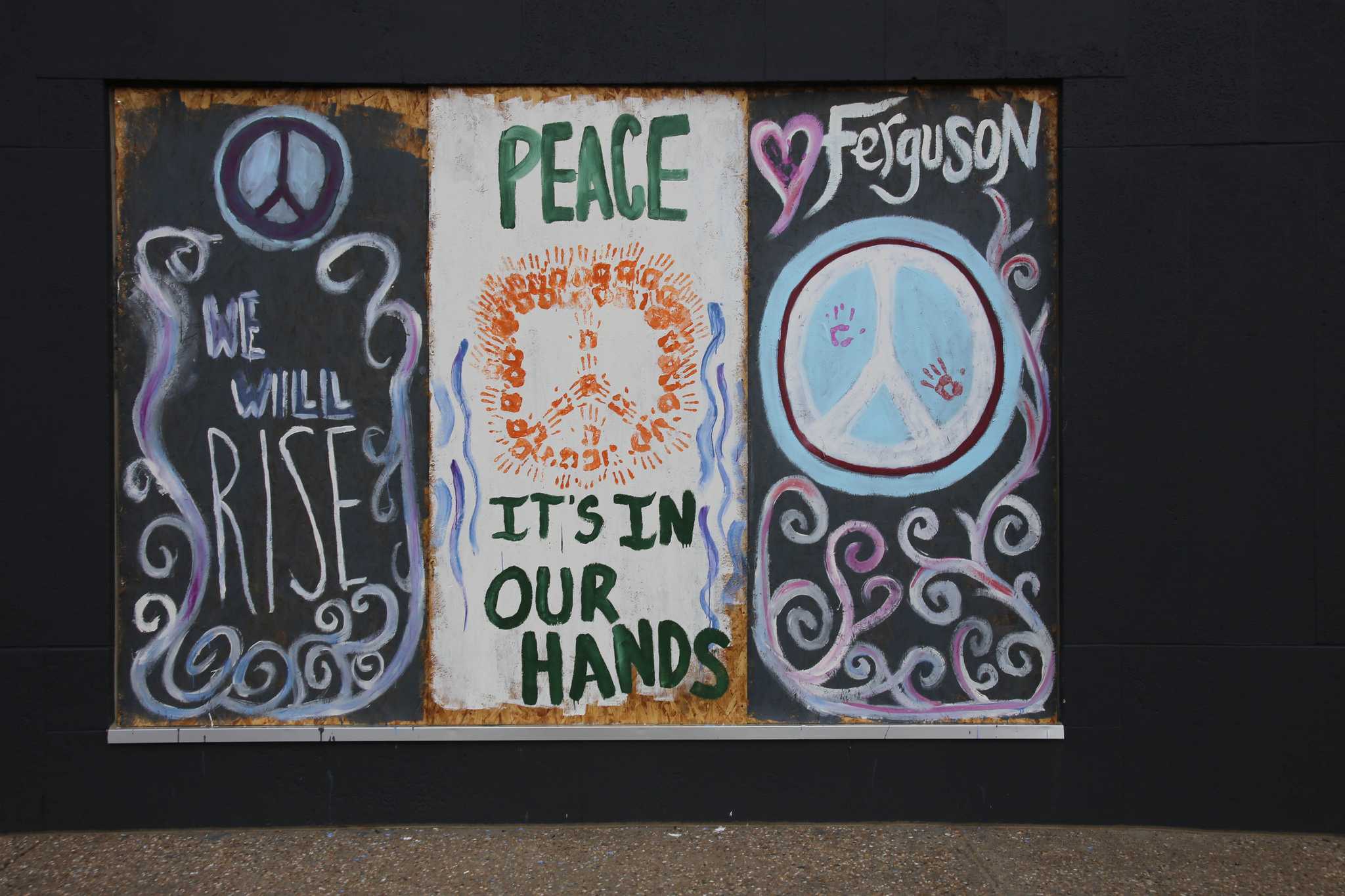 A Ferguson-themed window mural. Photo by Paul Sableman on Flickr.