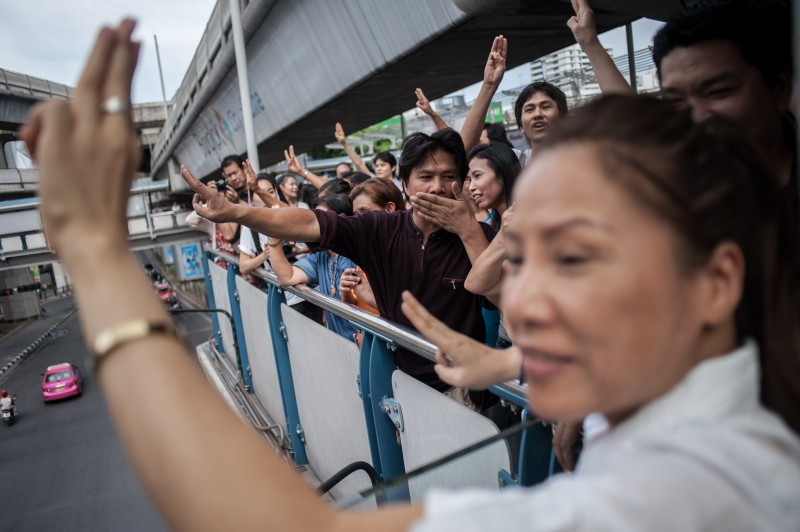 Anti-coup protesters show three-finger sign at Skywalk near Bangkok Art and Cultural Centre. Photo by Yostorn Triyos, Copyright @Demotix (6/1/2014)