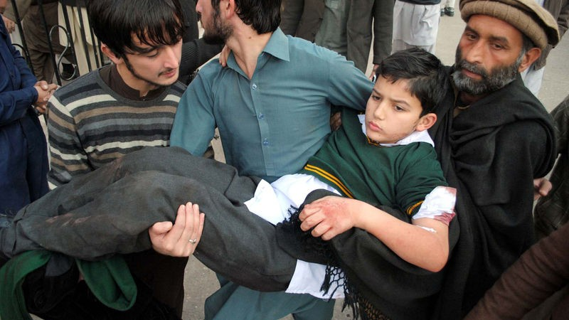 Victims of militants attacked an army public school situated on Warsak Road, being shifted for treatment at local hospital in Peshawar. Image by ppiimages. Copyright Demotix (16/12/2014)