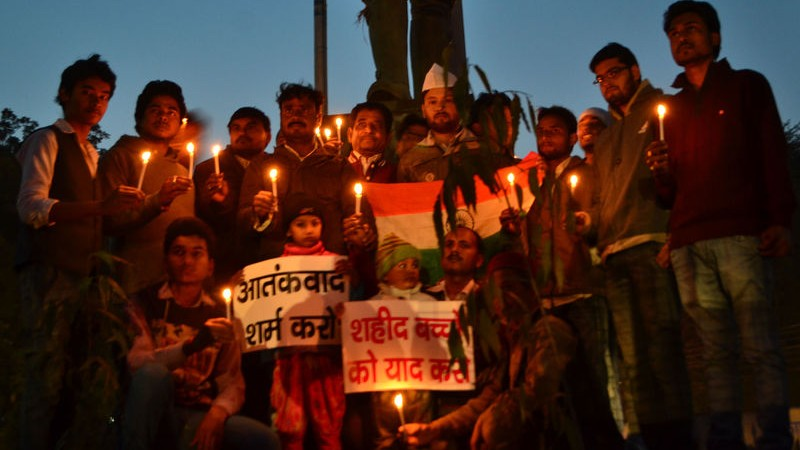 Indian congress workers and children pay tribute to those killed in the Taliban attack in Peshawar, Pakistan at a candle vigil in Allahabad, India. Image by Ritesh Shukla. Copyright Demotix (17/12/2014)