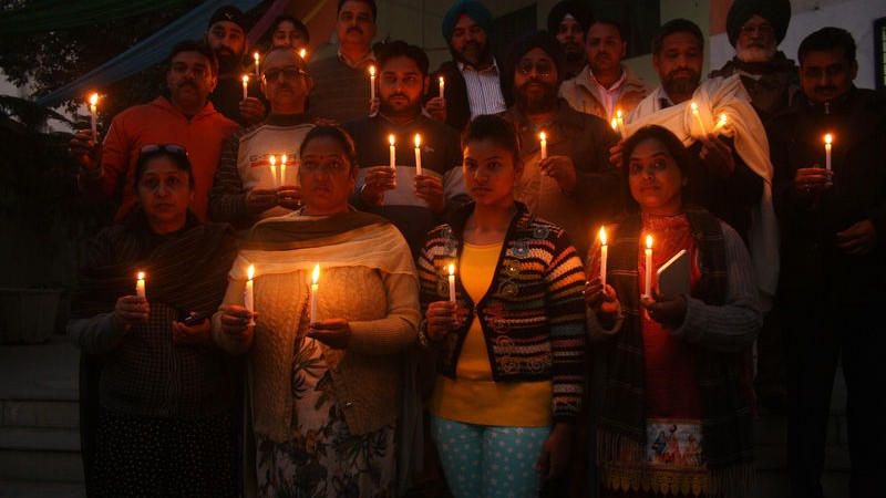 Indian people lit candles as they took part in a candle-light vigil in memory of victims killed in a Taliban attack on a military-run school in Peshawar, in Amritsar. Image by Sanjeev Syal. Copyright Demotix (17/12/2014)