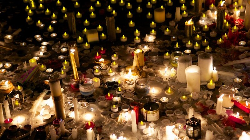 A collection of candles and votives lit as part of a vigil in Trafalgar Square, London, to remember the dead school children and teachers killed by the Pakistani Taliban in Pakistan. Image by Emma Durnford. Copyright Demotix (17/12/2014)