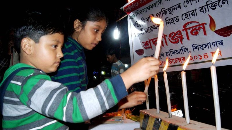Childrens in Sivasagar, Assam lighting candles protesting the attack of Talibans in a school of Pakistan,  image by Neelam Kakoty Majumdar. Copyright Demotix (18/12/2014)