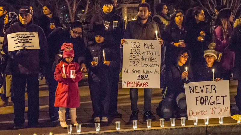Two hundred people gathered in front of the CNN Center in Atlanta for a candlelight vigil to honor victims killed during a Taliban attack on a school in Peshawar, Pakistan. Image by Steve Eberherdt Copyright Demotix (17/12/2014)