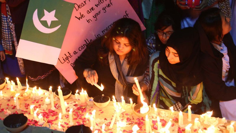 Students of Army Public School, members of Civil Society, Pak Army staffs and large numbers of citizens held a candle light vigil to mourn the innocent victims. Image by PPIImages. Copyright Demotix (19/12/2014)