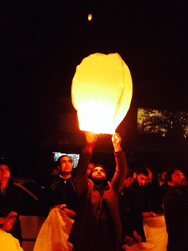 "Photo tweeted from vigil in Islamabad  by @Fmullick. ""In times of darkness we come together to bring light- @P_Y_A & @khudipk light lanterns for victims of #peshawarattack"""