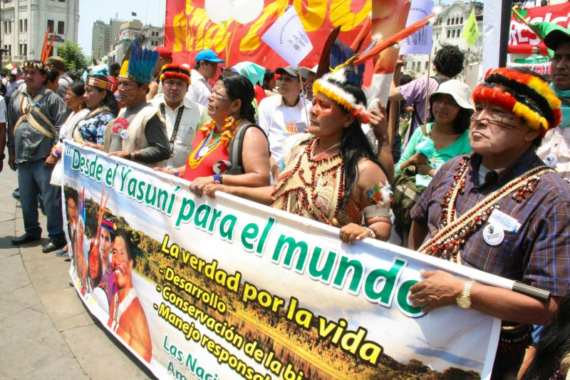 """Desde El Yasuni Para El Mundo."" Indigenous environmental activists from Yasuni, Ecuador relay a message to the world for the urgent protection of the Yasuni Amazon region from oil drilling. Photo credit: Hoda Baraka"