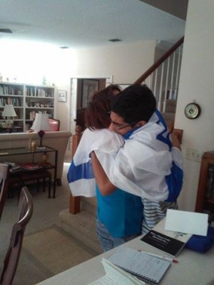Kay Wilson and Mohammad Zoabi embracing. (Source: Facebook)