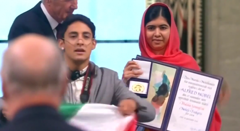 Mexican student Adan Cortes jumped onstage when the Pakistani teenager Malala Yousafzai was collecting her Nobel peace prize. Screenshot from YouTube Video.