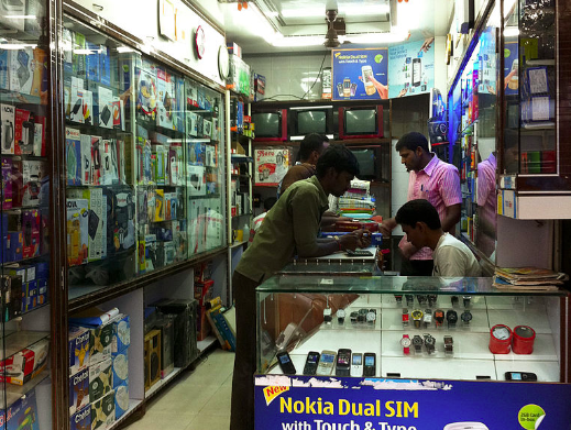Mobile phone shop in Mumbai. Photo by Victorgrigas via Wikimedia (CC BY-SA 3.0)