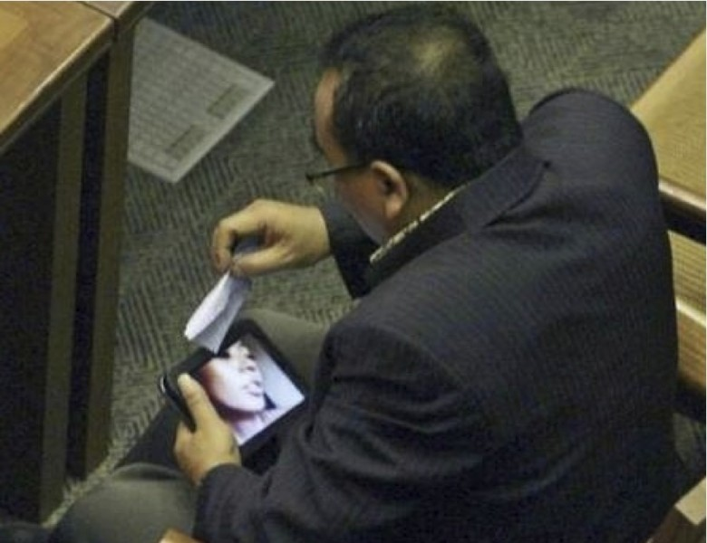 An Indonesian legislator caught watching porn in Congress. Photo widely shared on social media