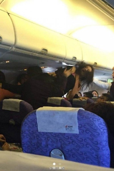 A viral photo circulated on Chinese social media on  a brawl among four women on a flight from mainland China to Hong Kong. Photo from Weibo.