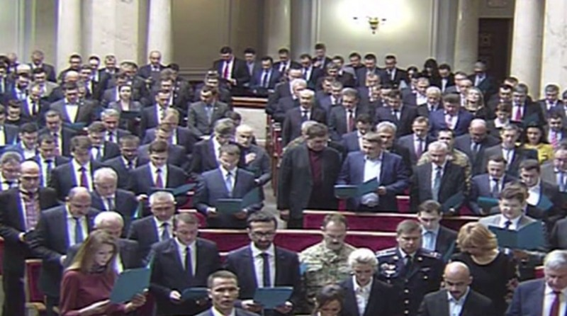 A screencapture of new Ukrainian Parliament members reading the oath