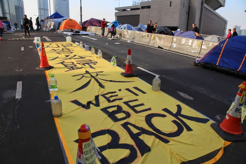 "There were more than 100 ""We'll be back"" banners hanging at the Admiralty protest site before then police clearance on December 11, blogger Au Ka Lun observes."