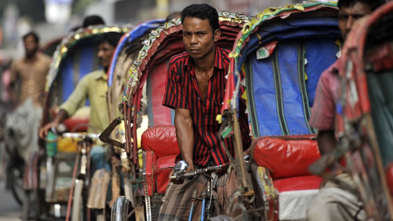 Rickshaws are the main means of transportation in Dhaka. Most of them send money to their rural home via mobile banking. Image by Mohammad Asad. Copyright Demotix (6/11/2013)