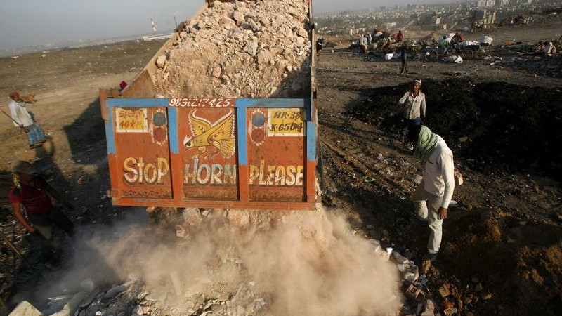 A truck dumps solid waste at Okhla Landfill in New Delhi, India. Photo by Anil kumar Shakya. Copyright Demotix (5/6/2014)
