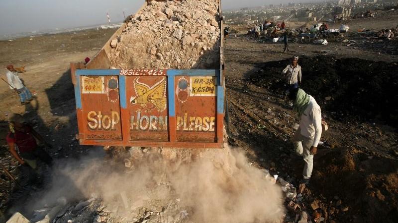 A truck dumps solid waste at Okhla Landfill in New Delhi, India. Photo by Anil kumar Shakya. Copyright Demotix (5/6/2014)