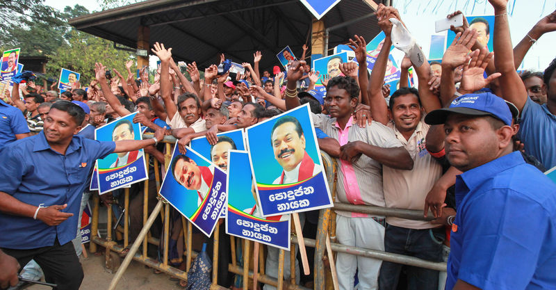 Supporters of Sri Lankan President Mahinda Rajapaksa cheer during an election campaign rally in Palmadulla, Sri Lanka. Image by Chamila Karunarathne. Copyright Demotix (3/1/2015)