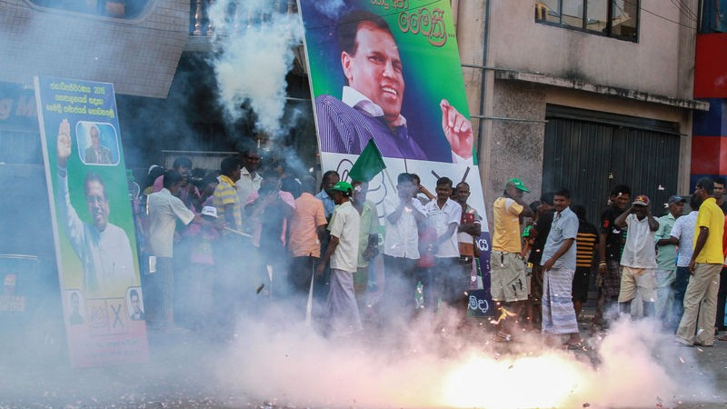 Supporters of Sri Lanka's main opposition presidential candidate Maithripala Sirisena burst firecrackers at the end of voting in the presidential election in Colombo. Image by Chamila Karunarathne. Copyright Demotix (8/1/2015)