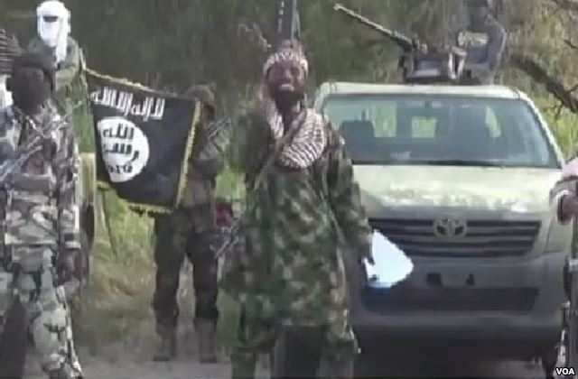 A screenshot from a propaganda video showing Boko Haram leader Abubakar Shekau. Public Domain photo from Voice of America.