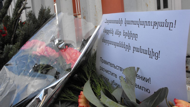 "One sign placed outside the embassy read """"Government of Armenia: Rid your country of an army of killers"" in Armenian and Russian."
