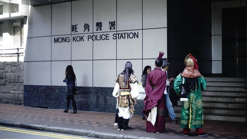 Three ancient Chinese heroes standing outside Mong Kok Police Station. Netizens wondered if they also had appointment with the police. Photo from Mocking Jer's Facebook Page.