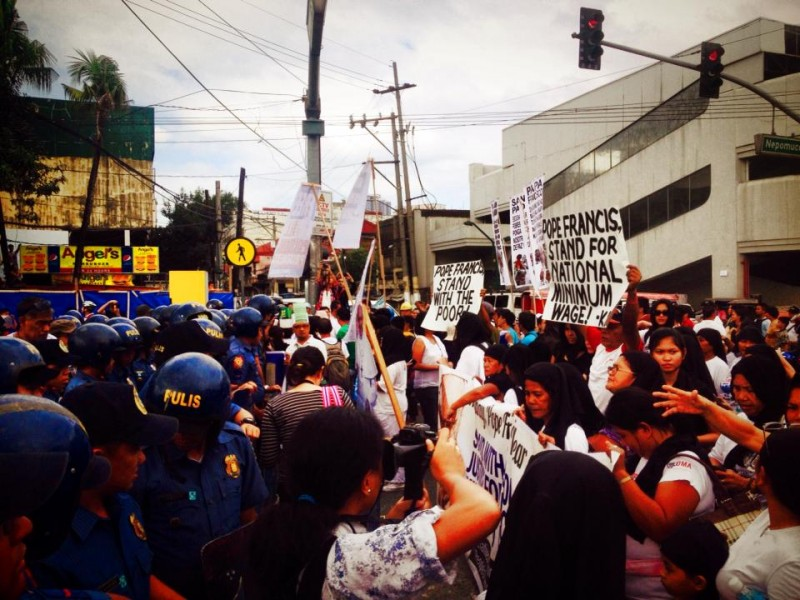 Human rights groups were blocked by the police from getting near the pope motorcade. Image from Facebook page of Kathy Yamzon