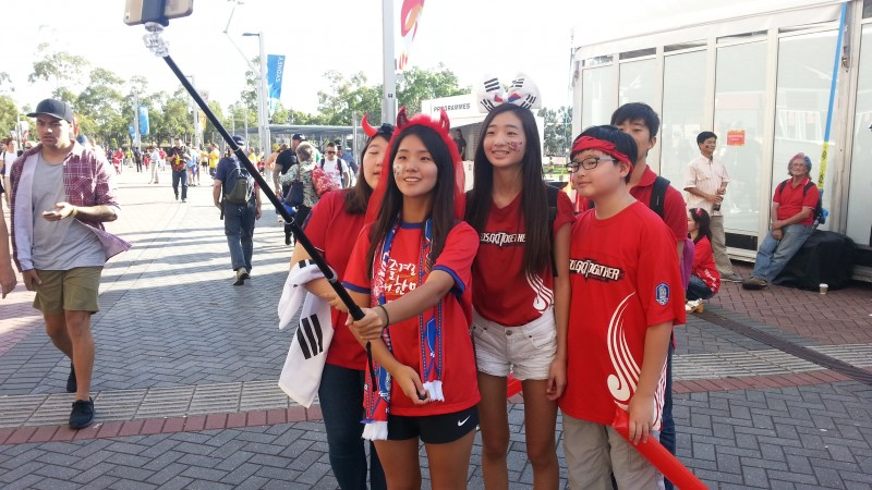 South Korea supporters taking a selfie before the match finals against Australia. Manuel Ribeiro