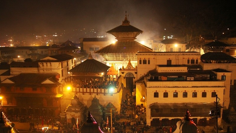 Priests performing aarati (burning lights) to worship Lord Shiva at Pashupatinath Temple on the eve of Maha Shivaratri in Kathmandu. Image by Sunil Sharma. Copyright Demotix (11/2/2010)
