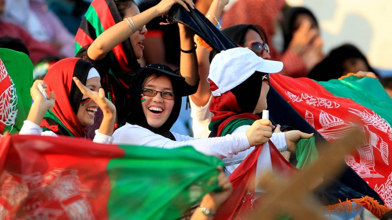 Demotix image ID: 4058137.  Afghanistan cricket fans wave flags during the match against Bangladesh in Asia Cup 2014 at Khan Saheb Osman Ali Stadium in Fatullah, Narayanganj. Image by md Manik.