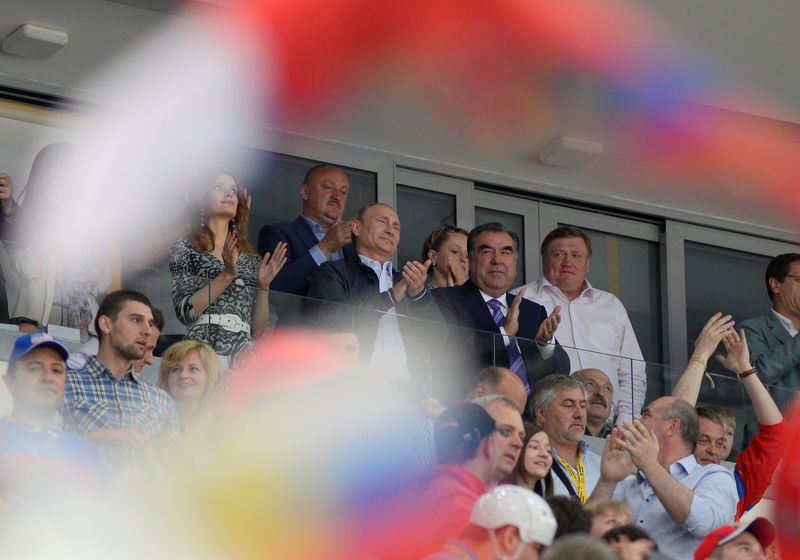 Tajik President Emomali stands alongside Vladimir Putin and Aleksandr Lukashenko as Russia win IIHF Ice Hockey World Championship. Photo by Ivan Uralsky. Demotix ID: 4848568.