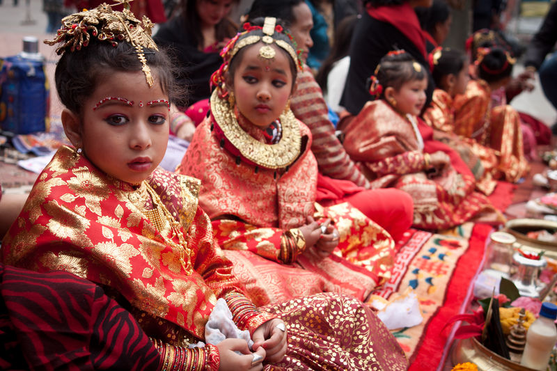 Girls from Newar community wearing traditional wedding dresses take part in Bael Bibaha, a practice where a girl is wed to a bael fruit, representing one of the gods, before her marriage. Image by  Nabin Baral. Copyright Demotix (3/12/2011)