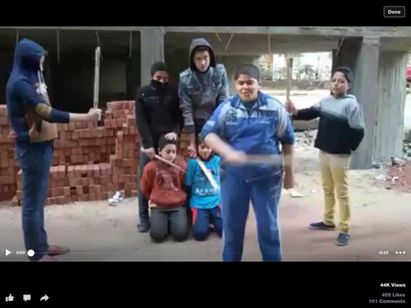 "Children in Mahalla, Cairo, role-playing the ISIS and ""slaughter"" other children ISIS-style. Photograph from a video shared by @Shokair on Twitter"