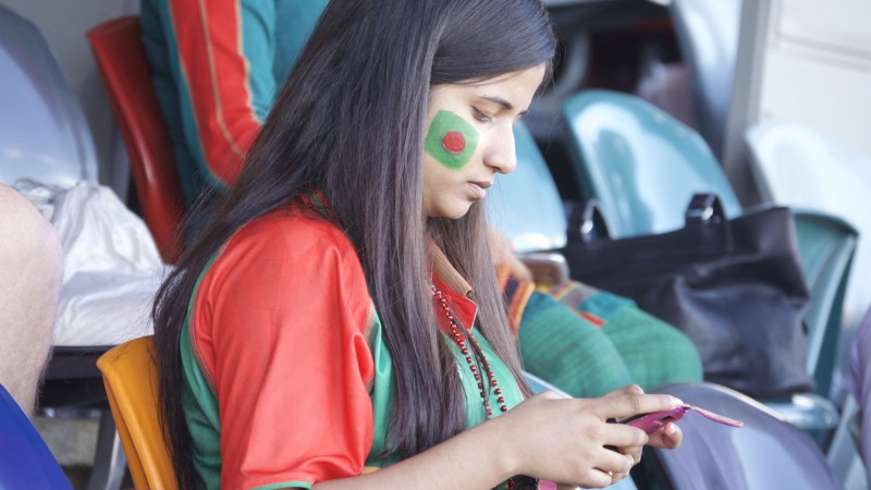 Bangladeshi supporters wore the green and red team jerseys which bore the colors of the Bangladeshi flag. Image by Rezwan