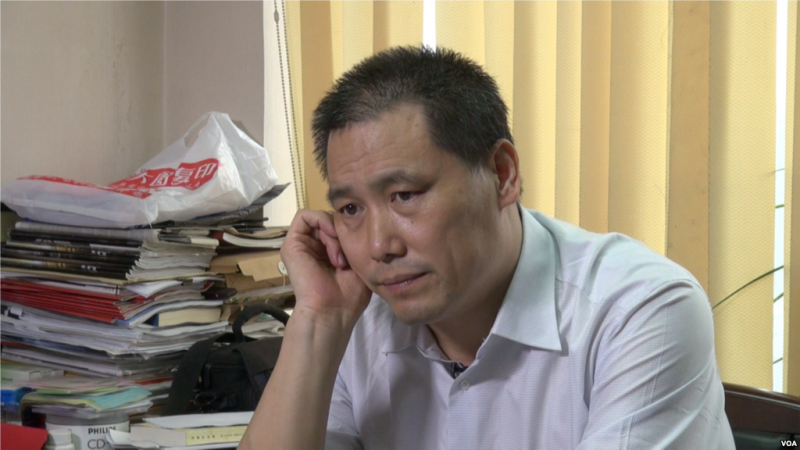Pu Zhiqiang. Photo by Voice of America, released to public domain.