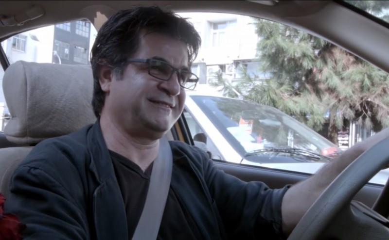 "Screenshot of Jafar Panahi from his film ""Taxi"" via YouTube user moviemaniacsDE"