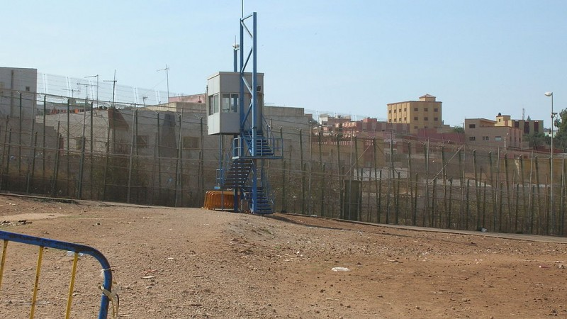 Border fence with guardpost at Spain-Morocco border by Melilla - CC-BY-2.0 via Acad Ronin