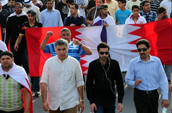 Abdulemam (center) walks in a protest march with Nabeel Rajab (left) and Abdulhadi Al-Khawaja. Photo by Mohamed CJ via Wikimedia (CC BY-SA 3.0)