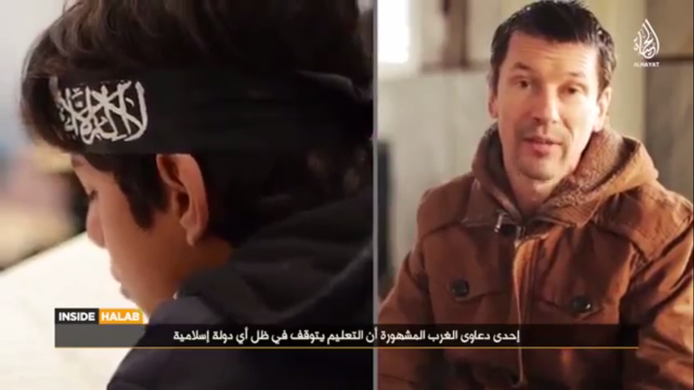A screen-shot of the latest IS propaganda video, highlighting British hostage John Cantlie as its reporter.