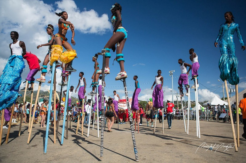 Moko Jumbies (stilt walkers) en masse. Photo by Quinten Questel, used under a CC BY-NC-ND 2.0 license.