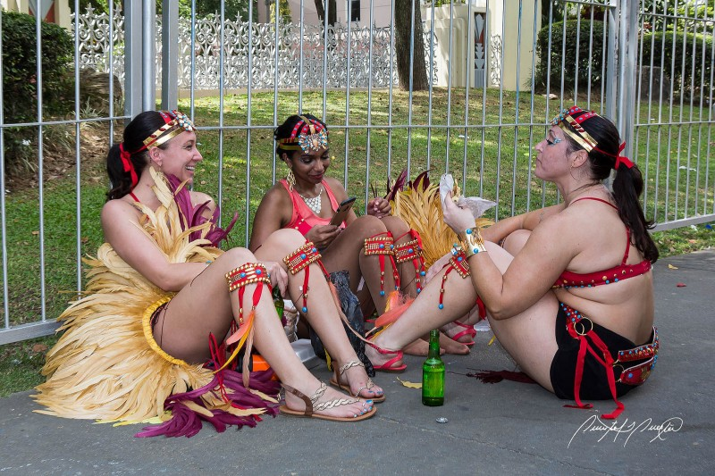 Friends take a break during the street parade. Photo by Quinten Questel, used under a CC BY-NC-ND 2.0 license.