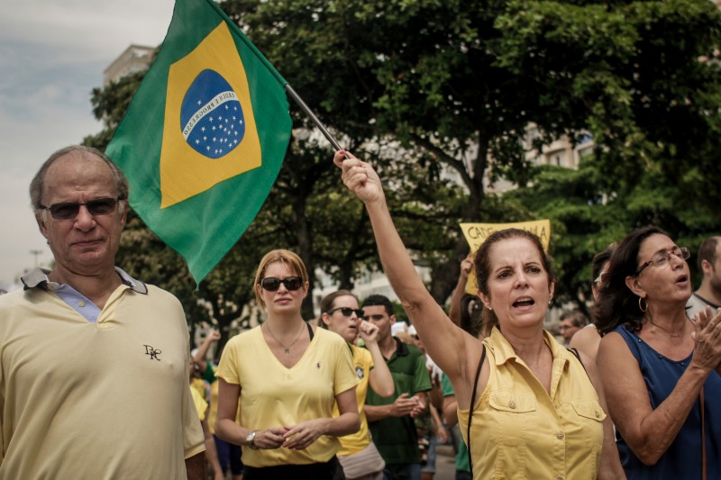 Demonstrators wearing the Brazilian flag's colors on Sunday