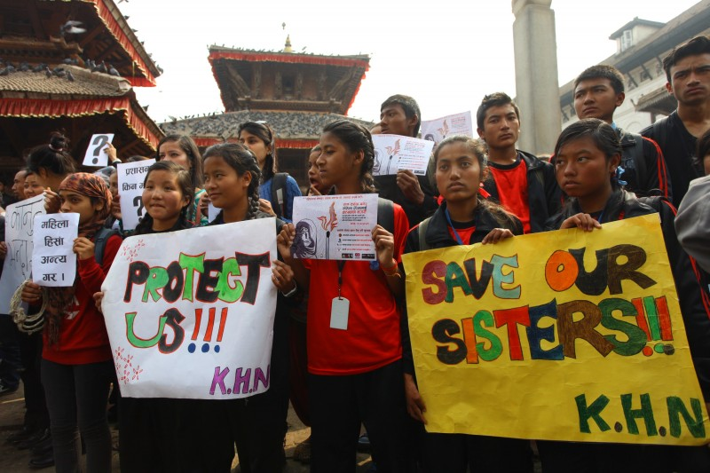 A protest on February 24, 2015, seeks justice for Sunday's acid attack on school girls Sangita Magar and Sima Basnet in Kathmandu, Nepal. Photo by Sunil Sharma. Copyright Demotix.