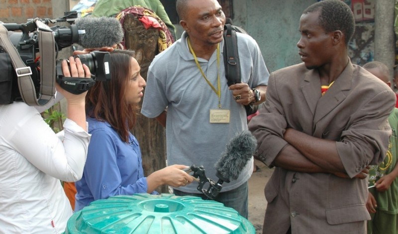 "BBC correspondent Tulip Mazumdar conducts an interview in Guinea in December 2014. ""They were telling me they didn't believe Ebola was a real virus,"" she says, but things have changed in the ensuing months. Credit: Courtesy of Tulip Mazumdar. Published with PRI's permission"