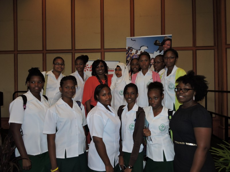 Dr. Camille Wardrop-Alleyne poses with secondary school students in Trinidad. Photo by Dawn Lafond, used with permission.