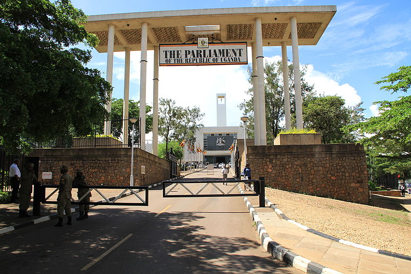 The main entrance to the Ugandan Parliament. Photo releases under Creative Commons by Andrew Regan.