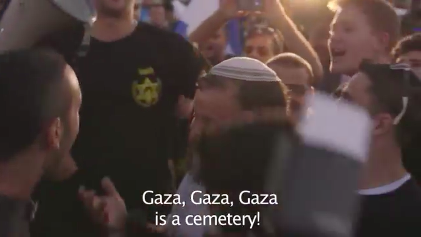 "Screenshot from 'Discarding Gaza' showing a Far-Right rally during the War on Gaza. They were chanting ""Gaza, Gaza, Gaza is a cemetery!"" and ""There are no schools in Gaza, because there are no children left in Gaza!"""