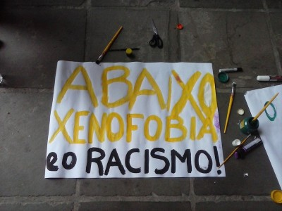 "One of the signs in the protest said: ""Down with xenophobia and racism"". Photo: Barricadas Abrem Caminhos/Facebook"